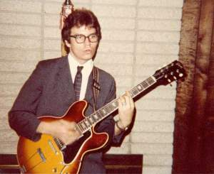 Playing a neighbor's Gibson arch-top 1980s